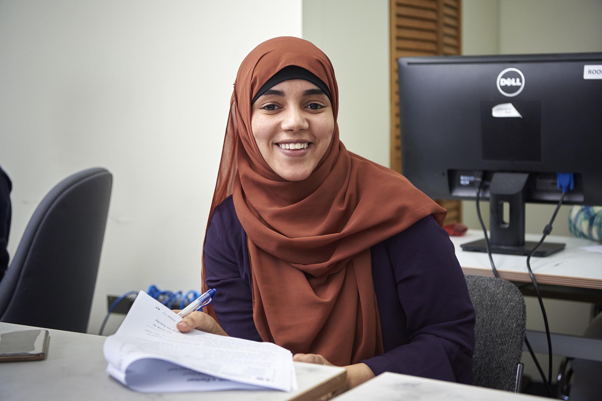 Newcomer woman attending a class
