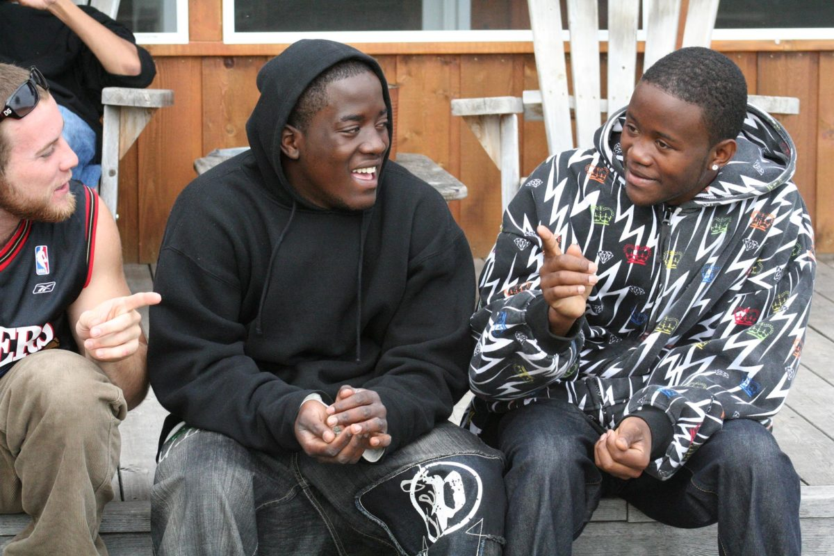 Youth smiling and talking